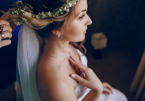 bride preparing for her wedding day in summer